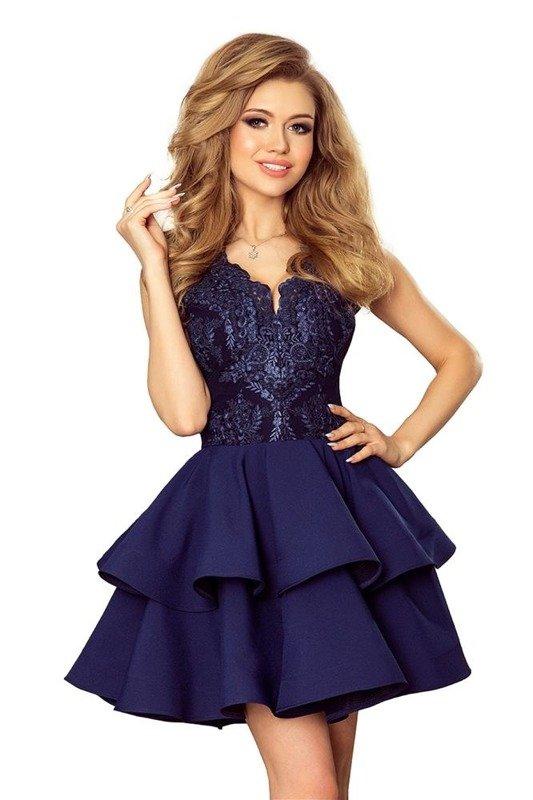 Wieczorowa sukienka z koronkową górą i fantazyjnie wyciętym dekoltem i rozkloszowanym dołem